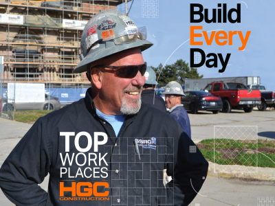 smiling construction worker with Top Work Places and HGC logo
