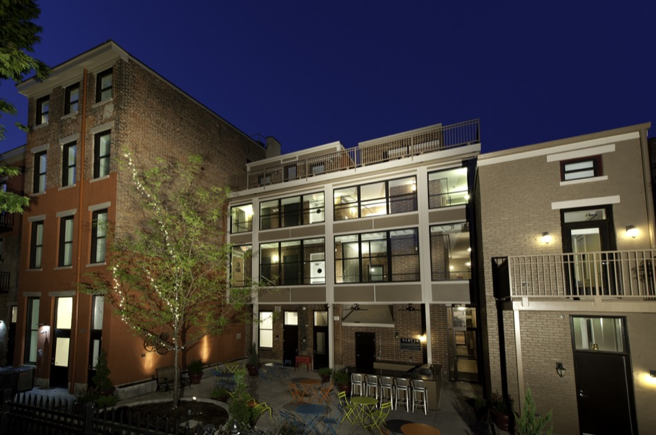 Parvis Lofts, renovated exterior patio and outdoor entertainment space at night
