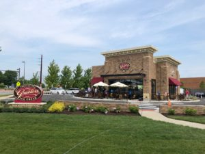 Standalone Graeter's Ice Cream shop on a sunny day with blue sky and few