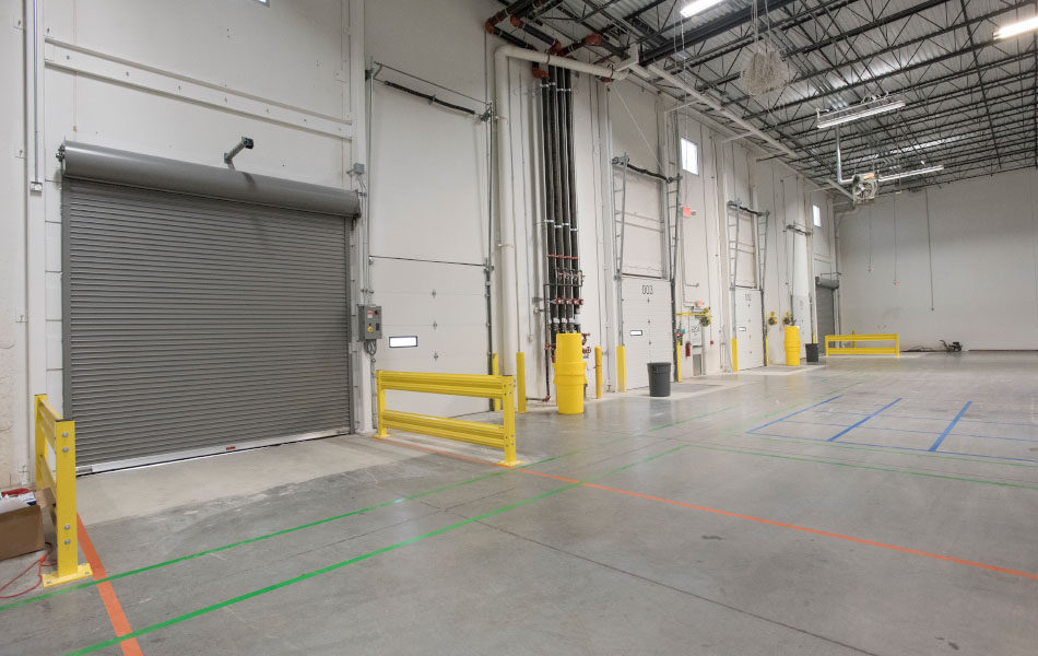Interior, large warehouse and dock bays