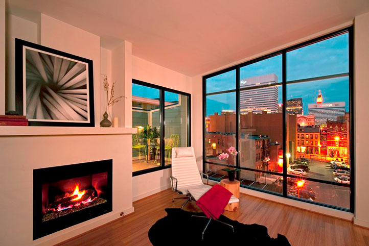 Lofts of Mottainai interior living room with large windows and city view