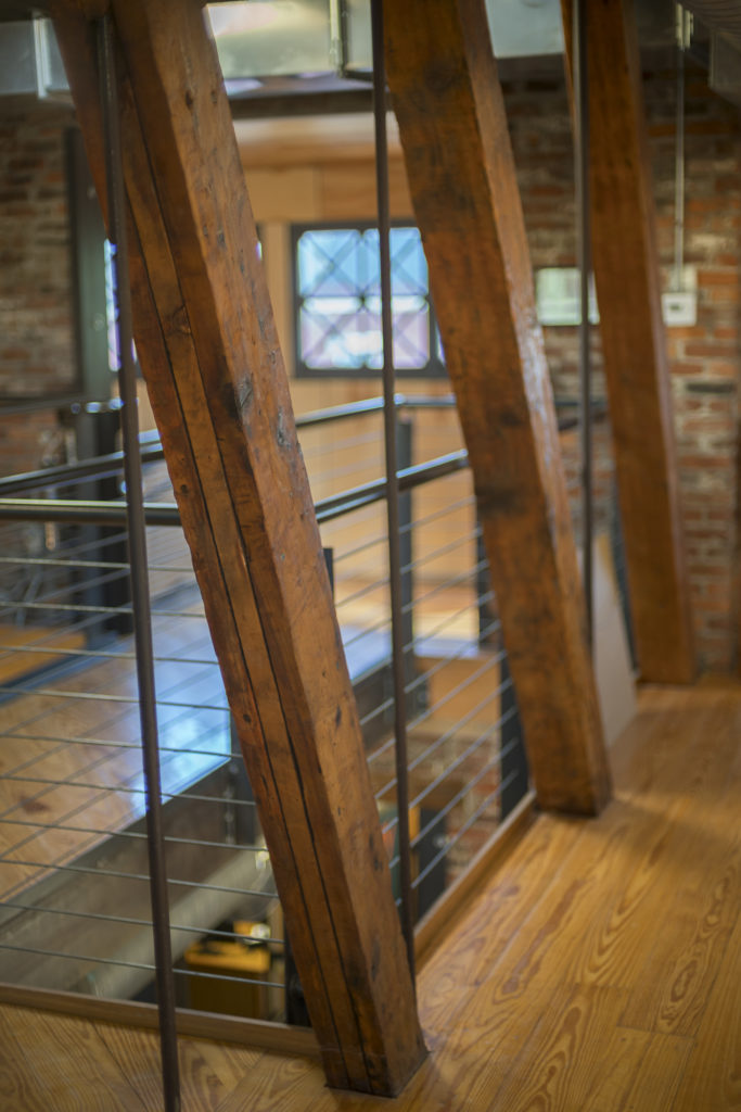 Reclaimed wood support beams at angle