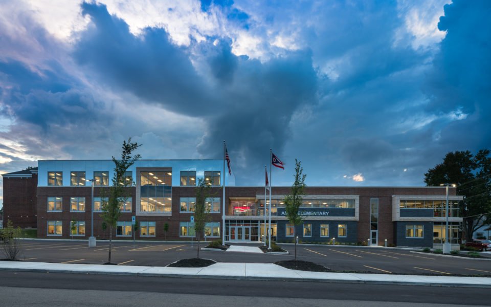 Exterior of modern brick elementary school at dusk