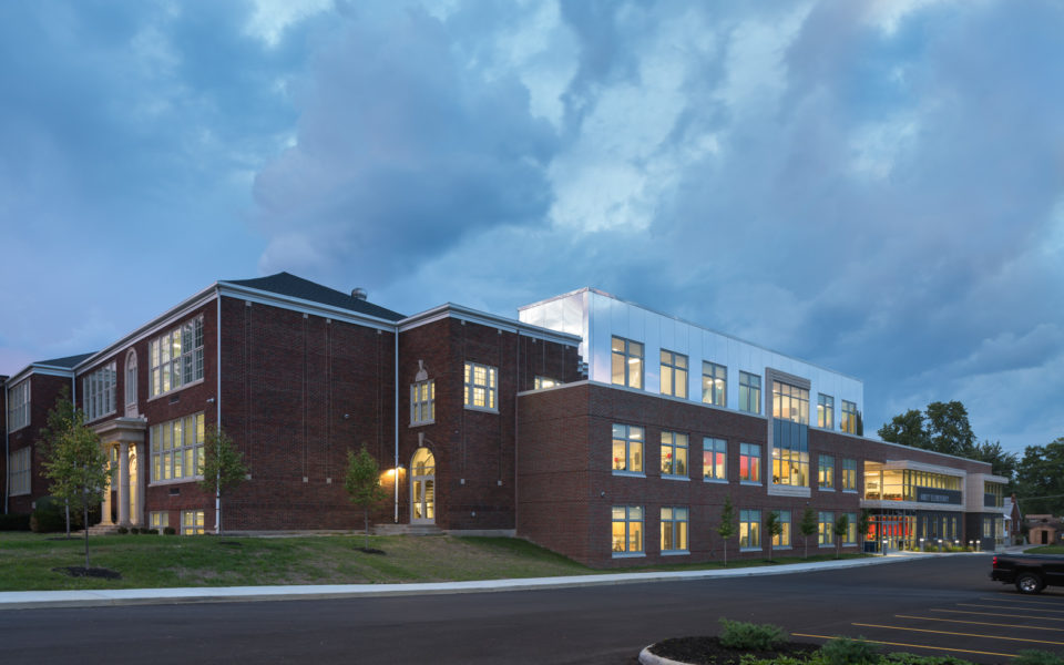 Exterior of brick elementary school at dusk