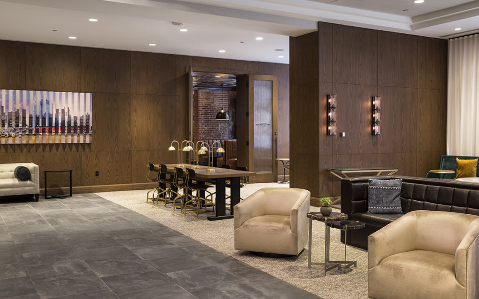 Hotel lobby with dark wood and luxurious seating