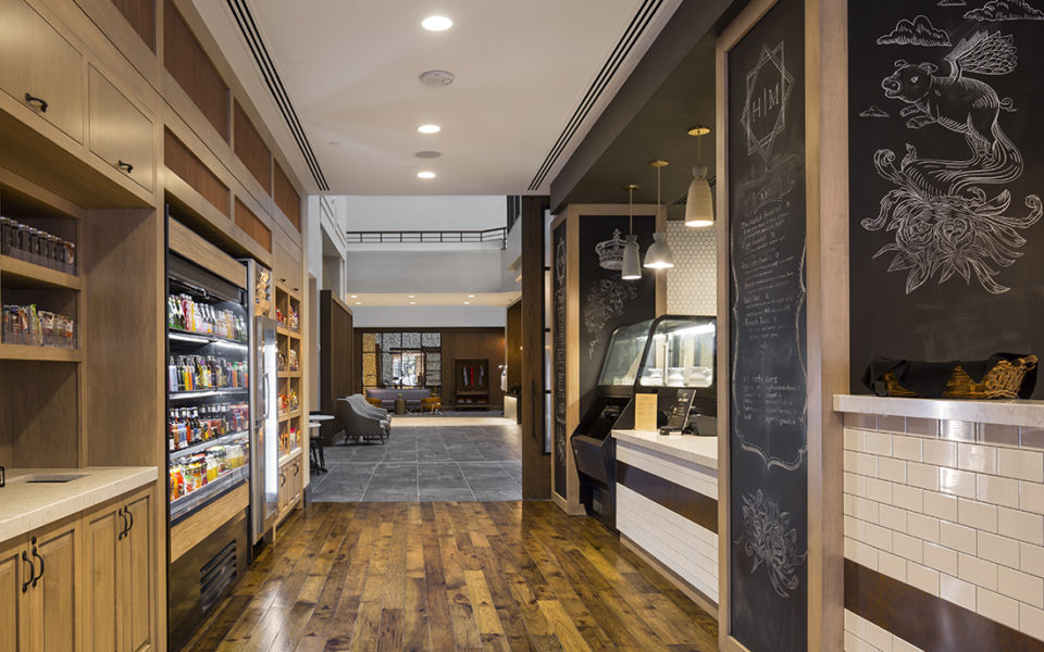 Market-style restaurant with stocked shelves and refrigerated cases