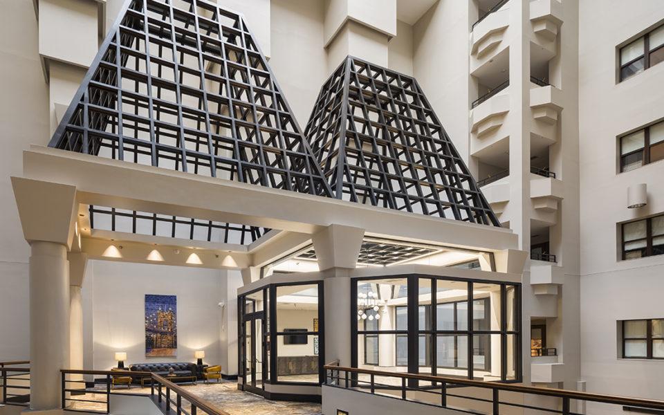 Second floor open hallway in grand foyer of a hotel