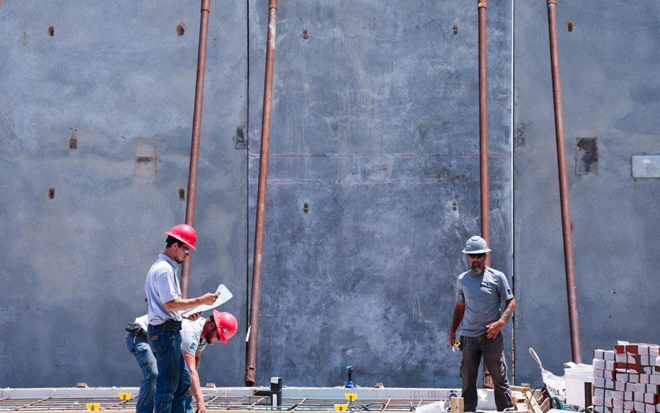 Three men working on tilt-up construction