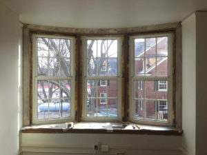 Bay window with old trim, ready for Miami University carpentry updates