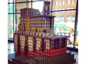 Train sculpture made of canned goods