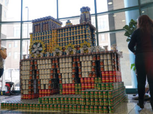 Canstruction sculpture of train