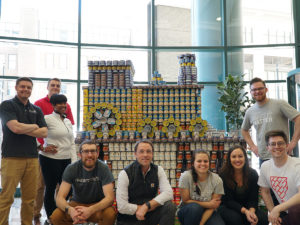 Team in front of canstruction sculpture