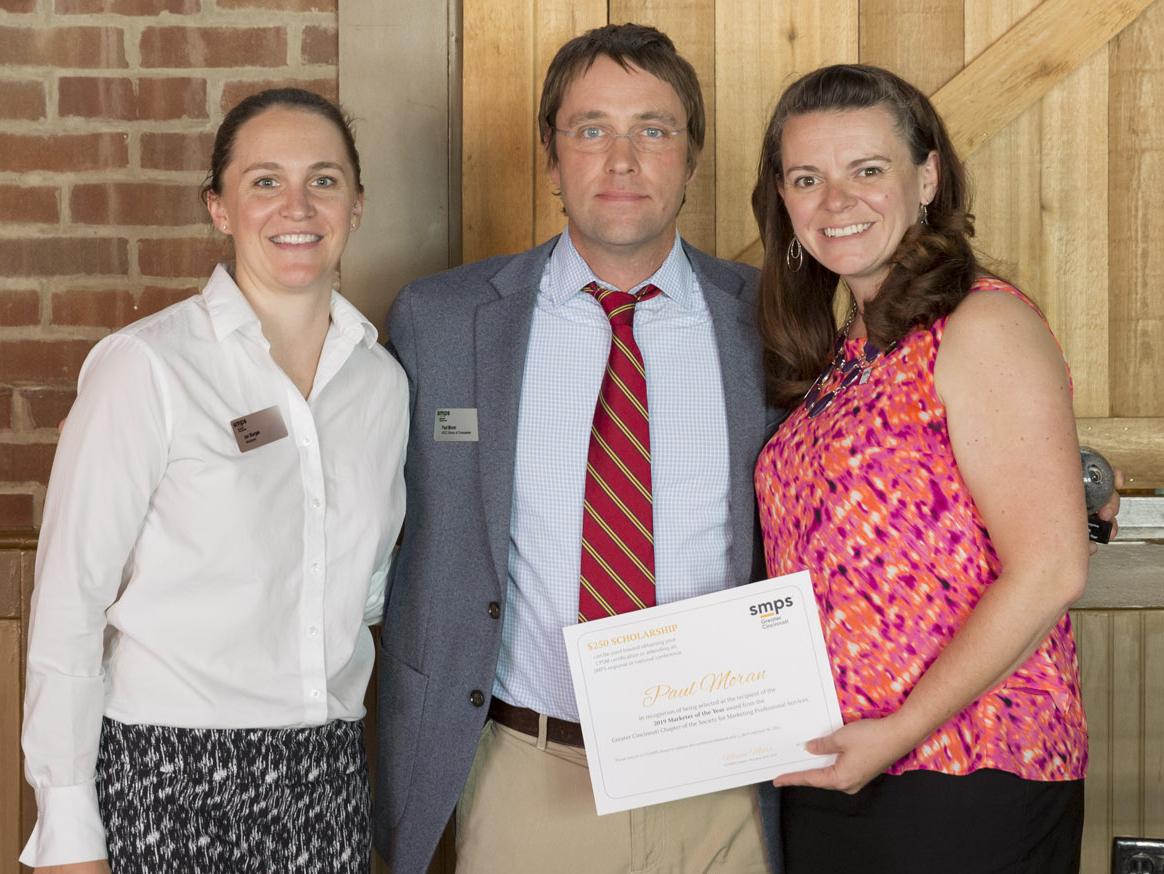 Paul Moran receiving GCSMPS Marketer of the Year Award
