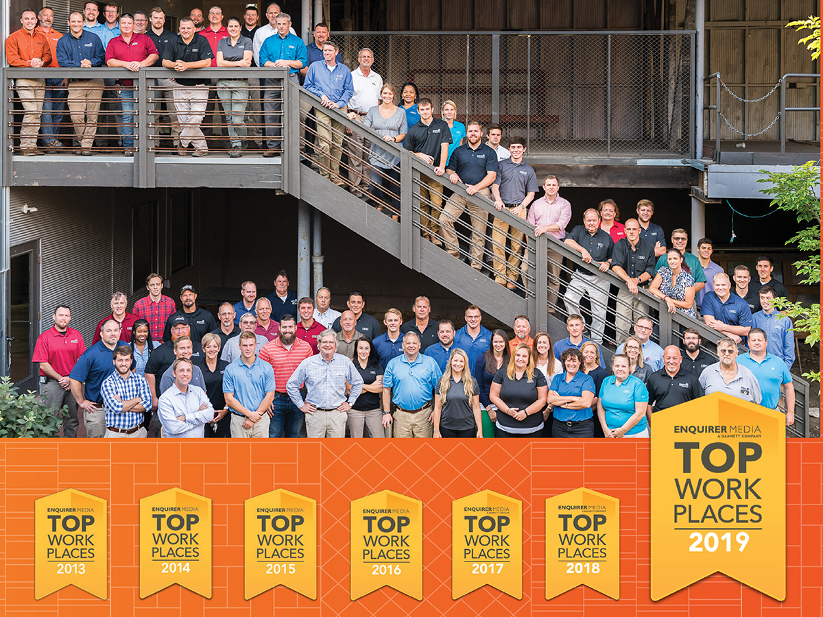 HGC employees and Top Workplace badges