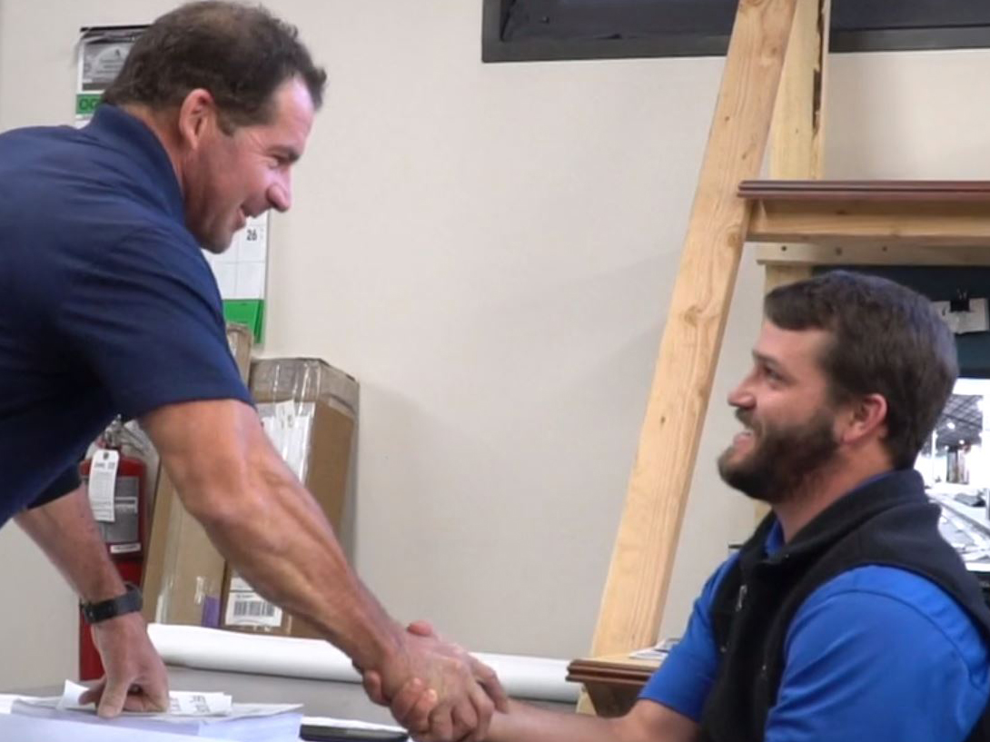 Bob Pitz shakes hands with a coworker