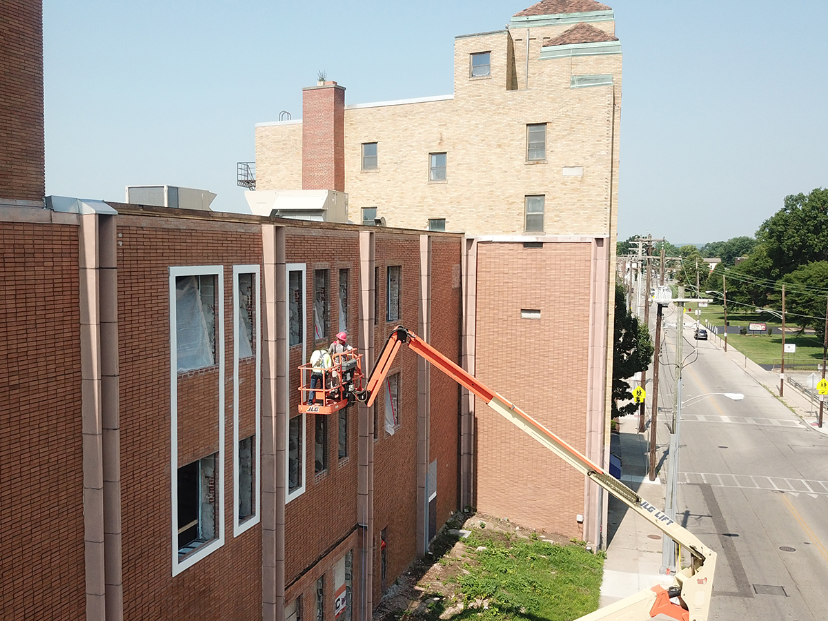 crane and exterior repairs in Norwood