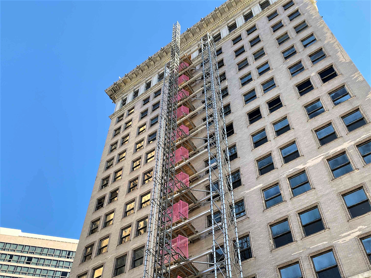looking up at Ingalls Building under construction with buckhoist