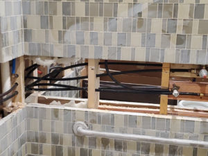 bathroom tiling and plumbing work in progress at Maple Knoll Coventry Court