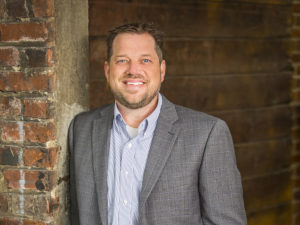 Portrait of Adam Kuehne, President of HGC Construction