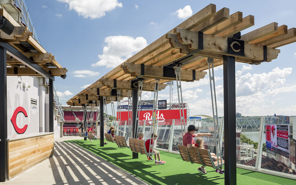 Families on swings at the TriHealth family pavilion at the Great American Ball Park
