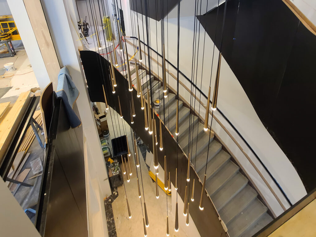 new light fixture in grand staircase in Ingalls Building