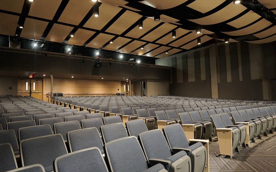 large theater with black seats from an angular view