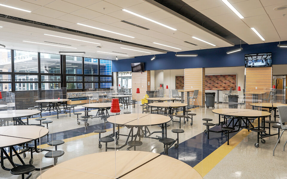 cafeteria with circular tables as part of madeira high school addition