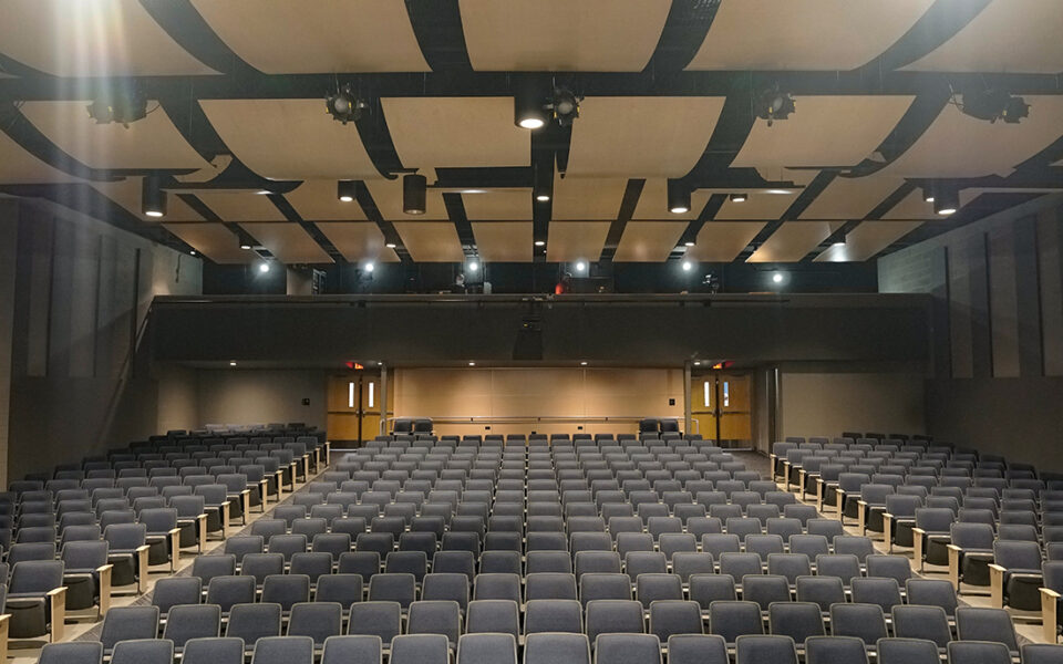 large theater with black seats