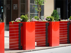 Cheerful red planters create the border of a parklet in downtown Cincinnati