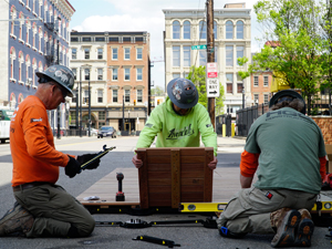 Self-Perform team installing parklets
